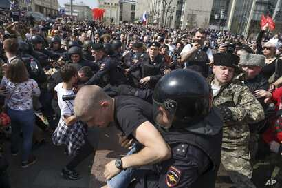 Russian police detain protesters at a demonstration against President Vladimir Putin in Pushkin Square as Russians angered by the impending inauguration of Vladimir Putin to a new term as the country's president demonstrated throughout the country on...