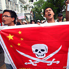 Vietnamese protesters hold a Chinese flag with a pirate sign during a protest in Hanoi, Vietnam, June 19, 2011