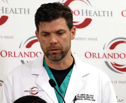 Dr. Chadwick Smith, one of the doctors who treated victims of the Pulse nightclub shooting, describes how he and others called for reinforcements that night, at a news conference at the Orlando (Fla.) Regional Medical Center, June 14, 2016.