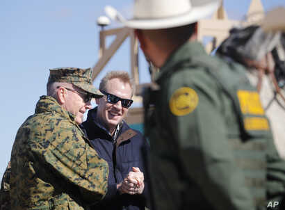 Acting Secretary of Defense Patrick Shanahan, center, and Joint Chiefs Chairman Gen. Joseph Dunford, left, meet with Border Patrol Agents during a tour of the U.S.-Mexico border at Santa Teresa Station in Sunland Park, N.M., Feb. 23, 2019.