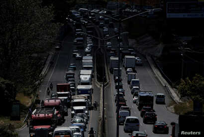 Vehicles sit in traffic on the main highway leading to San Jose, Costa Rica, Jan. 30, 2018.