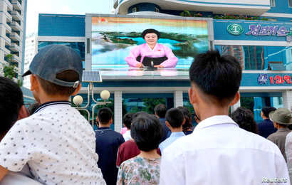 North Koreans watch a news report showing North Korea's nuclear test in Pyongyang, North Korea, Sept. 3, 2017. (Kyodo/via Reuters)