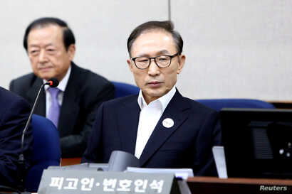 FILE - Former South Korean President Lee Myung-Bak appears for his first trial at the Seoul Central District Court, May 23, 2018, in Seoul, South Korea.