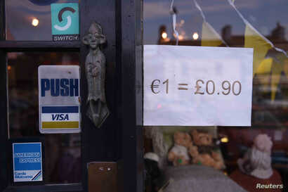 A shop indicating it's euro and sterling currency exchange rate is seen in the border town of Belleek, Northern Ireland, Oct. 14, 2016.