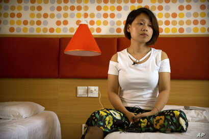Deng Guilian, the wife of detained Chinese labor activist Hua Haifeng, speaks during an interview in Ganzhou in southeastern China's Jiangxi Province, June 6, 2017.