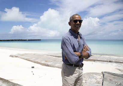 President Barack Obama looks stands at Turtle Beach to speak to the media as he tours Midway Atoll in the Papahanaumokuakea Marine National Monument, Northwestern Hawaiian Islands.