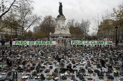 """Hundreds of pairs of shoes are displayed at the place de la Republique, in Paris, as part of a symbolic and peaceful rally called by the NGO Avaaz """"Paris sets off for climate"""", Nov. 29, 2015."""