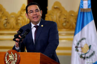 Guatemala's President Jimmy Morales delivers a message at the National Palace of Culture in Guatemala City, Guatemala, Sept. 6, 2018.