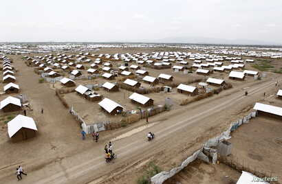 An aerial view shows recently constructed houses at the Kakuma refugee camp in Turkana District, northwest of Kenya's capital Nairobi, June 20, 2015.