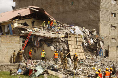 Rescuers work at the site of a building collapse in Nairobi, Kenya, June 13, 2017.