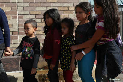 Children form a line as undocumented immigrant families are released from detention at a bus depot in McAllen, Texas, June 22, 2018.