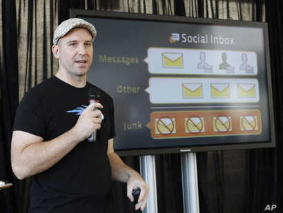 FILE - Andrew Bosworth, then a Facebook engineer, talks about the new Facebook messaging service at an announcement in San Francisco, Nov. 15, 2010. Now a Facebook vice president, he said in an internal memo in 2016 that the social media company nee...