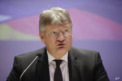 Jörg Meuthen, leader of Alternative For Germany party, talks to journalists during a press conference in Milan, April 8, 2019.