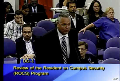 FILE - This Feb. 18, 2015 image taken from video provided by Broward County Public Schools shows school resource officer Scot Peterson during a school board meeting of Broward County, Fla.
