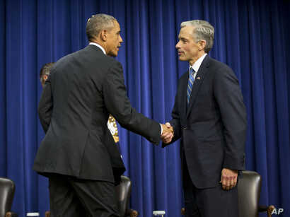 President Barack Obama shakes hands with John Walsh, U.S. Attorney, District of Colorado, following a forum on criminal justice reform, Oct. 22, 2015.