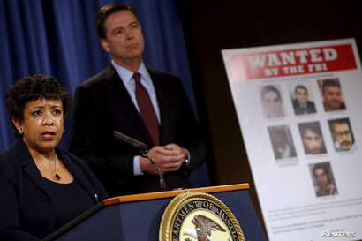 U.S. Attorney General Loretta Lynch and FBI Director James Comey hold a news conference to announce indictments on Iranian hackers for a coordinated campaign of cyber attacks on several U.S. banks and a New York dam, at the Justice Department in Wash...