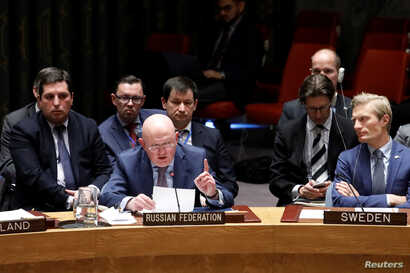 Russian Ambassador to the United Nations Vassily Nebenzia speaks during a United Nations Security Council meeting on a chemical weapons watchdog report that concluded a nerve agent was used in the attempted murder of former Russian spy Sergei Skripal...