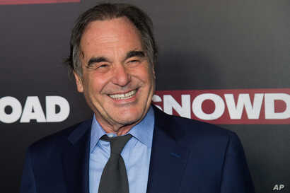 """Oliver Stone attends the premiere of """"Snowden"""" at AMC Loews Lincoln Square in New York, Sept. 13, 2016."""