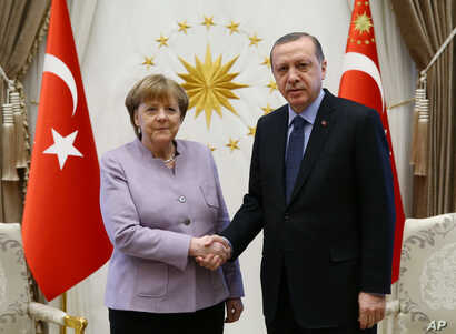 FILE - Turkey's President Recep Tayyip Erdogan, right, meets with German Chancellor Angela Merkel at the Presidential Palace in Ankara, Turkey, Feb. 2, 2017.
