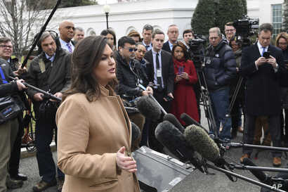 White House press secretary Sarah Sanders speaks to reporters outside the White House in Washington,  April 2, 2019.