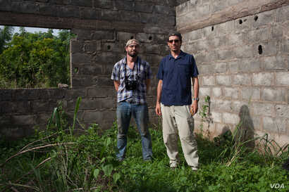 Peter DiCampo and writer Austin Merrill in Ivory Coast.