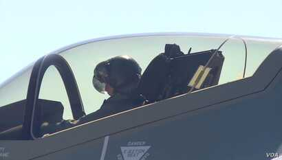 """Major Will """"D-Rail"""" Andreotta in the cockpit of an F-35 fighter jet."""