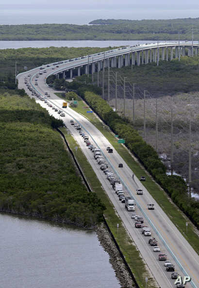 Motorists head north on US 1, Sept. 6, 2017, in Key Largo, Fla., in anticipation of Hurricane Irma.  Keys officials announced a mandatory evacuation Wednesday for visitors, with residents being told to leave the next day.