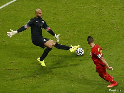 Goalkeeper Tim Howard of the U.S. blocks a shot by Belgium's Kevin Mirallas during their round of 16 game at the Fonte Nova arena in Salvador ,July 1, 2014.