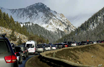 Traffic backs up on Interstate 70 in Colorado, a familiar scene on the main highway connecting Denver to the mountains, Jan. 7, 2018.