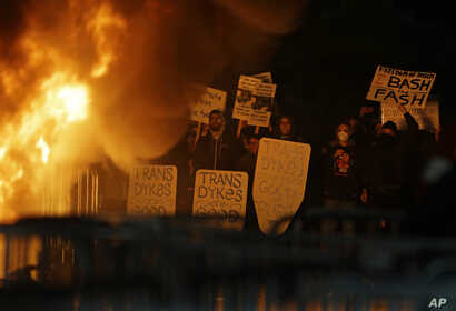 Protestors watch a fire on Sproul Plaza during a rally against the scheduled speaking appearance by Breitbart News editor Milo Yiannopoulos on the University of California at Berkeley campus, Feb. 1, 2017, in Berkeley, Calif.