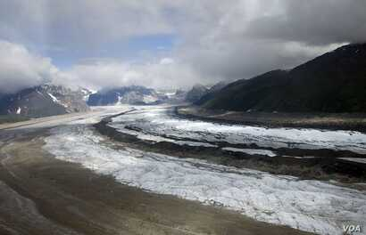 Alaska's Ruth Glacier in Denali National Park. Ruth Glacier is a glacier in Denali National Park and Preserve in the U.S. state of Alaska. Its upper reaches are almost three vertical miles (4.8 km) below the summit of Mount McKinley. .(Carol M. Highs...