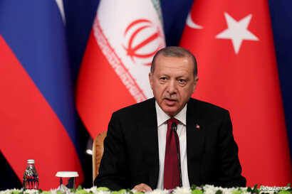 Turkish President Tayyip Erdogan speaks during a news conference with President Hassan Rouhani of Iran and Vladimir Putin of Russia following their meeting in Tehran, Iran, Sept. 7, 2018.