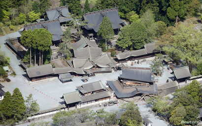 Romon gate (bottom R), designated as a nationally important cultural property, and other buildings damaged by an earthquake are seen at Aso Shrine in Aso, Kumamoto prefecture, southern Japan, in this photo taken by Kyodo, April 16, 2016.