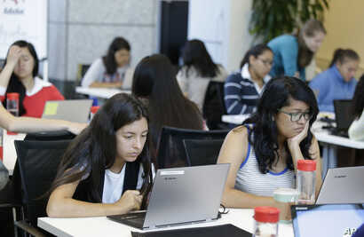 FILE - Students are seen completing an exercise at a Girls Who Code class in San Jose, California, June 18, 2014. Girls Who Code, a national non-profit, aims to prepare young women for futures in computing-related fields.