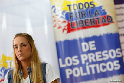 """Lilian Tintori, wife of jailed Venezuelan opposition leader Leopoldo Lopez, attends a news conference at the office of the party Popular Will (Voluntad Popular) in Caracas, Venezuela, Jan. 18, 2017. The text reads, """"All for the freedom of political p..."""