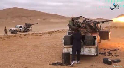 A still image taken Dec. 11, 2016, from a video released by Islamic State-affiliated Amaq news agency Dec. 10, 2016, purports to show Islamic State fighters advancing over the Hayan mountain south of Palmyra.