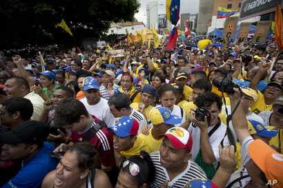 People chant against the government of President Nicolas Maduro during a march in Caracas, Venezuela, May 14, 2016. Protesters demanded electoral officials accelerate the certification of the petition signatures that would kick off a recall of Maduro...