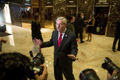 Iowa Gov. Terry Branstad speaks to members of the media in the lobby of Trump Tower in New York, Dec. 6, 2016.