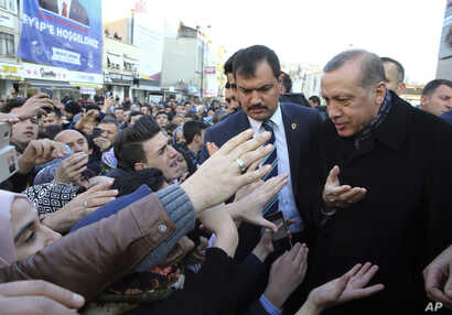Turkey's President Recep Tayyip Erdogan speaks with his supporters as he arrives for the openıng ceremony ata hıgh school in Istanbul, Dec. 3, 2016.
