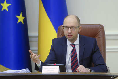 Ukrainian Prime Minister Arseniy Yatsenyuk speaks during Cabinet in Kiev, Ukraine, Nov. 25, 2015.