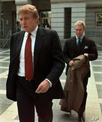 FILE - Billionaire real estate developer Donald Trump, left, walks to the Federal Courthouse in Newark, N.J., with Roger Stone, the director of Trump's presidential exploratory committee, Oct. 25, 1999, for the swearing-in of Trump's sister as a fede...