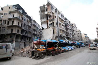 Stalls are seen on a street beside damaged buildings in the rebel held al-Shaar neighborhood of Aleppo, Syria, Feb. 10, 2016.