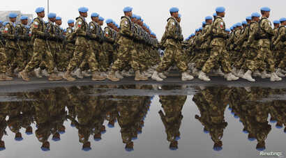 FILE - Indonesia's U.N peacekeeping force marches during a ceremony to commemorate the 65th military anniversary at a base in Jakarta, Oct. 5, 2010.