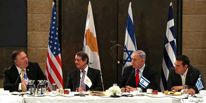 Israeli Prime Minister Benjamin Netanyahu, U.S. Secretary of State Mike Pompeo, Greek Prime Minister Alexis Tsipras and Cypriot President Nicos Anastasiades chat during their meeting in Jerusalem, March 20, 2019.