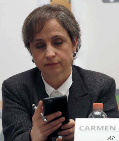 Mexican journalist Carmen Aristegui checks her phone during a press conference in Mexico City, June 19, 2017. An internet watchdog has found that Mexican journalists, lawyers and activists were targeted by Israeli-produced spyware that is sold exclus...