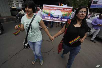FILE - Members of the lesbian, gay, bisexual and transgender community and their supporters from across India participate in a pride walk in Surat in Gujarat state, India, Oct. 6, 2013. The walk was organized for the first time in the Gujarat state d...