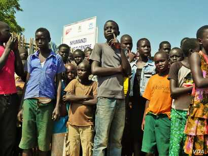 Children at Nyumanzi Transit Center await the arrival of Grandi. The UNHCR says the vast majority of refugees are women and children.