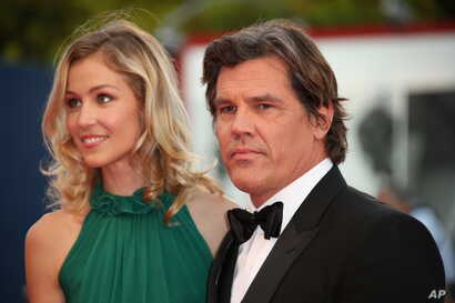 Kathryn Boyd and Josh Brolin pose for photographers upon the red carpet of the film Everest and the opening ceremony of the 72nd edition of the Venice Film Festival in Venice, Italy, Sept. 2, 2015.