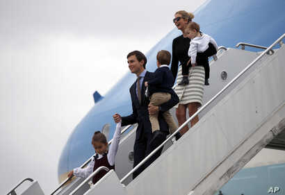 FILE - Arabella Kushner, her father, White House senior adviser Jared Kushner, carrying Joseph Kushner, and Ivanka Trump, carrying Theodore Kushner, step off Air Force One at the Palm Beach International Airport, in West Palm Beach, Florida, March 3,...