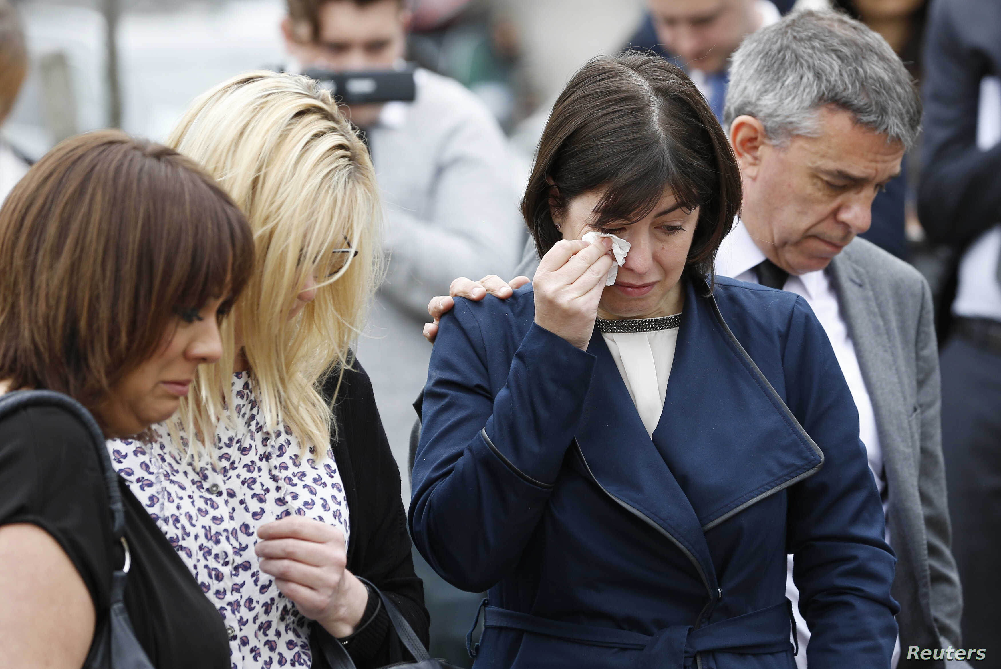 Labour MP's (L-R) Paula Sheriff, Lucy Powell, and Jeff Smith, and former Labour Party councillor Karen Rowling (2nd L), leave tributes near the scene of the murder of Labour Member of Parliament Jo Cox in Birstal near Leeds, Britain, June 17, 2016.  ...